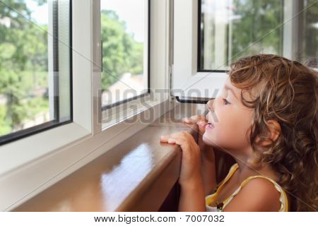 Pretty Smiling Little Girl On Balcony, Look From Window