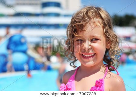 Pretty Little Girl Near Pool In Aquapark Of An Entertaining Complex