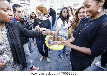 Passing out candles for moment of silence