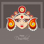 Illustration of the face of Goddess Durga with beautiful eyes wearing a golden nose ring and a heavy colourful crown decorated with red and white pearls.   poster