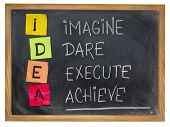 idea acronym (imagine, dare, execute,achieve) - motivation concept - colorful sticky notes and chalk handwriting on a blackboard poster