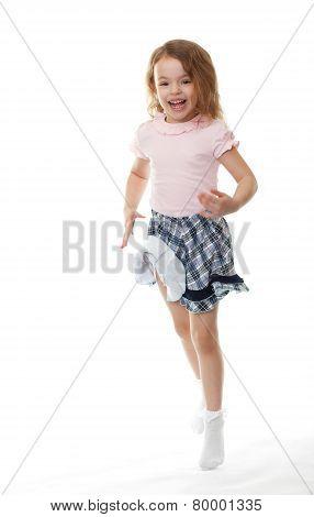 Joyful little girl jumps.