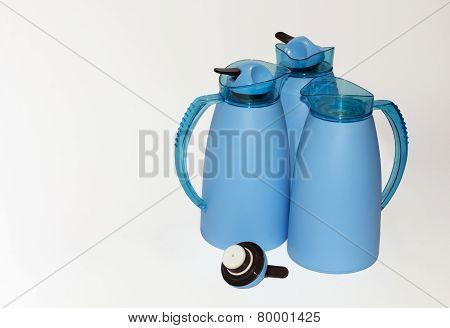 Three Blue Thermoses