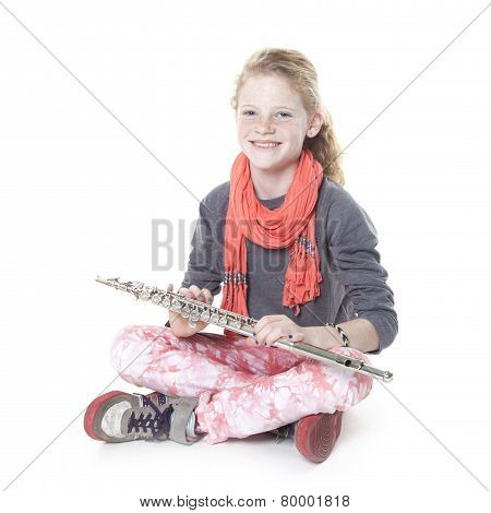 Young Girl With Red Hair And Freckles With Flute