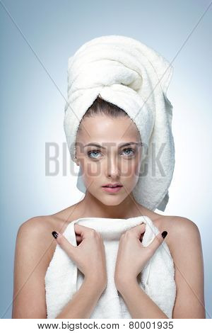 Portrait of a beautiful woman with fresh skin after bath. Spa concept