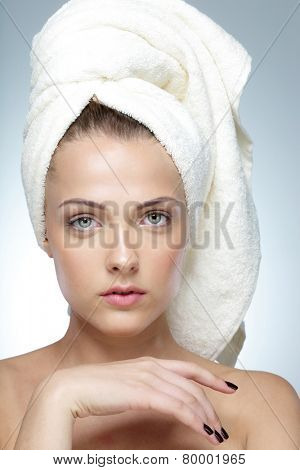 Closeup portrait of a beautiful woman with perfect skin and towel on head