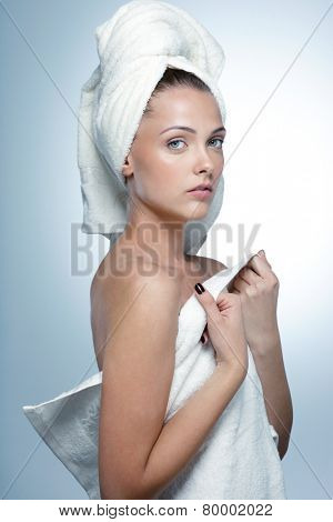 Portrait of attractive young girl after bath. Spa concept