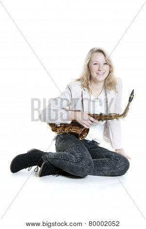 Teenage Girl With Saxophone In Studio With White Background