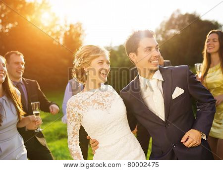 Newlyweds with guest on their garden party