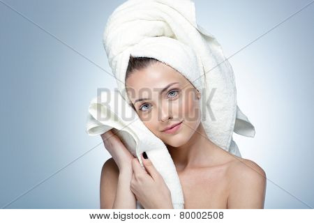 Portrait of attractive woman with perfect skin and towel on head