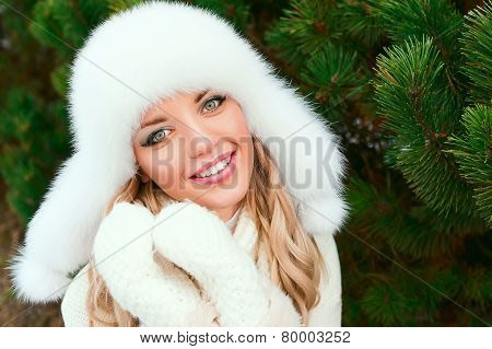 Happy woman in a winter forest