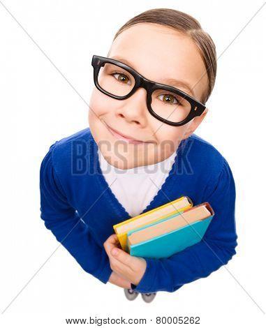 Funny little girl is holding books, fisheye portrait, isolated over white