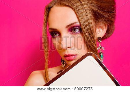 Beautiful girl in fashion dress with  clutch