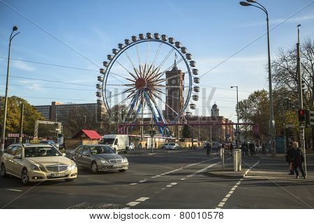 BERLIN, GERMANY - NOV 17, 2014: View of Ferris Wheel at Alexanderplatz. Currently began a complete reconstruction of area, by 2019 there will be many high-rise buildings that will complement her image