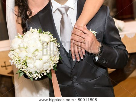 Married Couple With Bouquet Of Peonies