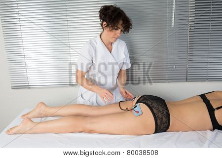 Woman Is Doing Massage Of Electrostimulator For Her Body