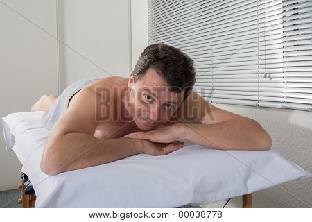 Man Lying On The Massage Table Waiting For A Massage