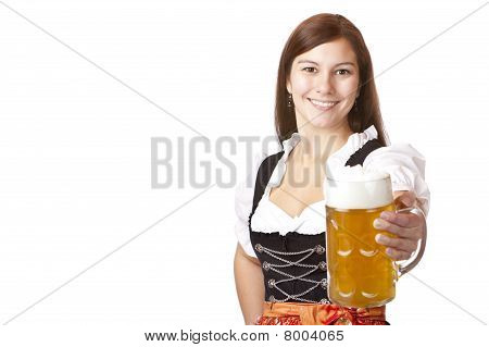 Happy Bavarian woman holding Oktoberfest beer stein (Mass) in camera.