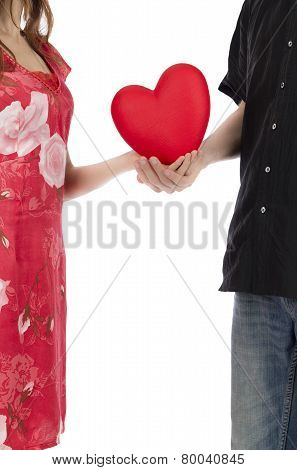 Couple Hand In Hand Holding A Red Heart