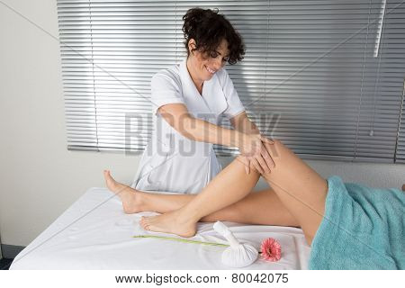 A Picture Of A Physio Therapist Giving Knee Massage