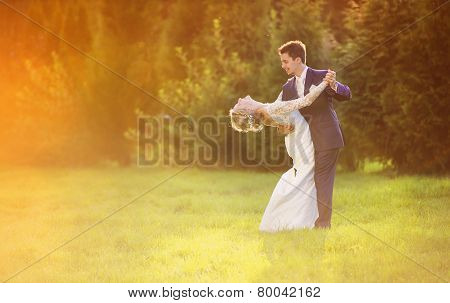 Young wedding couple on summer meadow