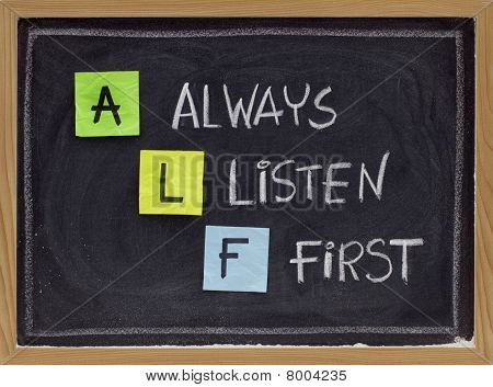 ALF acronym (always listen first) - good advice for training counselling customer service selling or relationships sticky notes and white chalk handwriting on blackboard poster