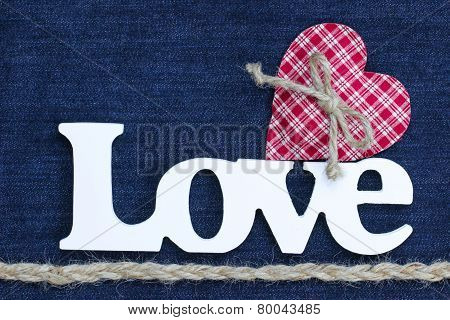 Love text with red heart and rope border on blue denim background