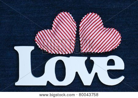 Wood Love text with red hearts on denim background