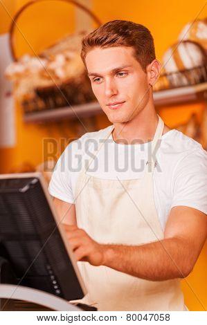 Confident Cashier At Work.