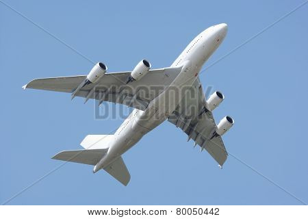 Airplane in Clear blue sky.