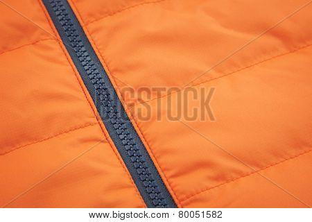 Orange waterproof textile with black zip lock background