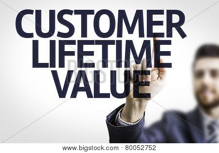 Business man pointing to transparent board with text: Customer Lifetime Value poster