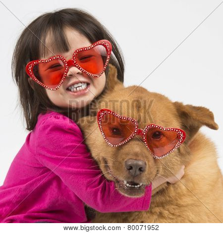 Dog Hugged By Child
