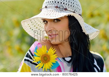 young pretty woman on blooming field in summer