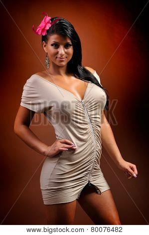 beautiful young sensual woman posing in short dress - studio shot
