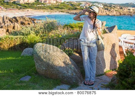 Young beautiful girl during summer vacation