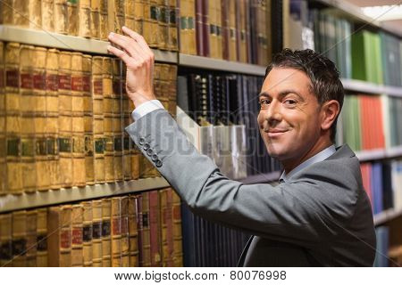 Lawyer picking book in the law library at the university
