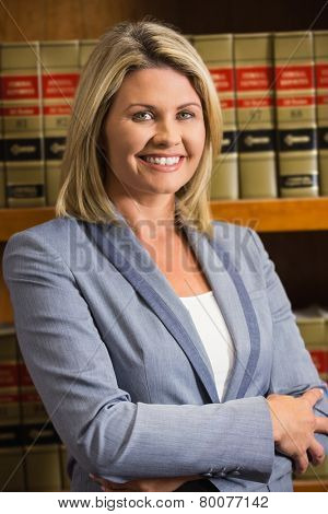 Lawyer smiling at camera in law library at the university