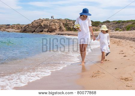 Young mother and adorable little daughter during summer vacation
