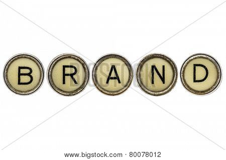 brand word in old round typewriter keys isolated on white