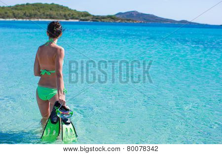 Young beautiful woman with snorkel in blue sea