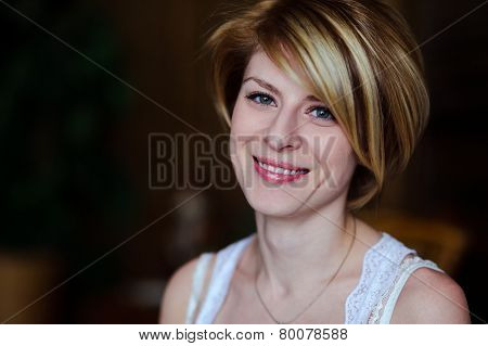 Beauty portrait of a young woman with beautiful smile