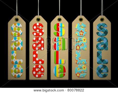 Paper labels with coloful SALE word on black background