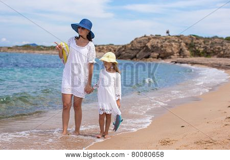 Young mother and her adorable little daughter during summer vacation