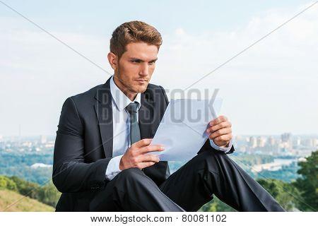 Man Examining Contract.