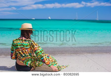 Young girl on seashore during summer vacation