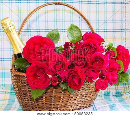 Roses And A Bottle Of Champagne In A Basket