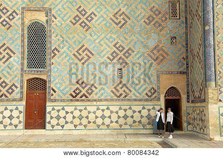 Women explore mausoleum of Khoja Ahmed Yasavi in Turkistan, Kazakhstan.