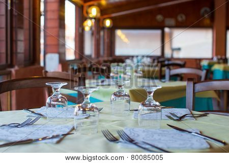 Served table set at restaraunt in the evening
