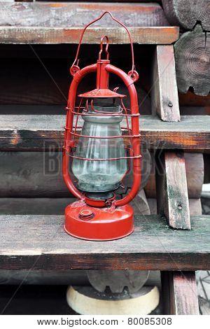Kerosene lamp on wooden stairs, outdoors